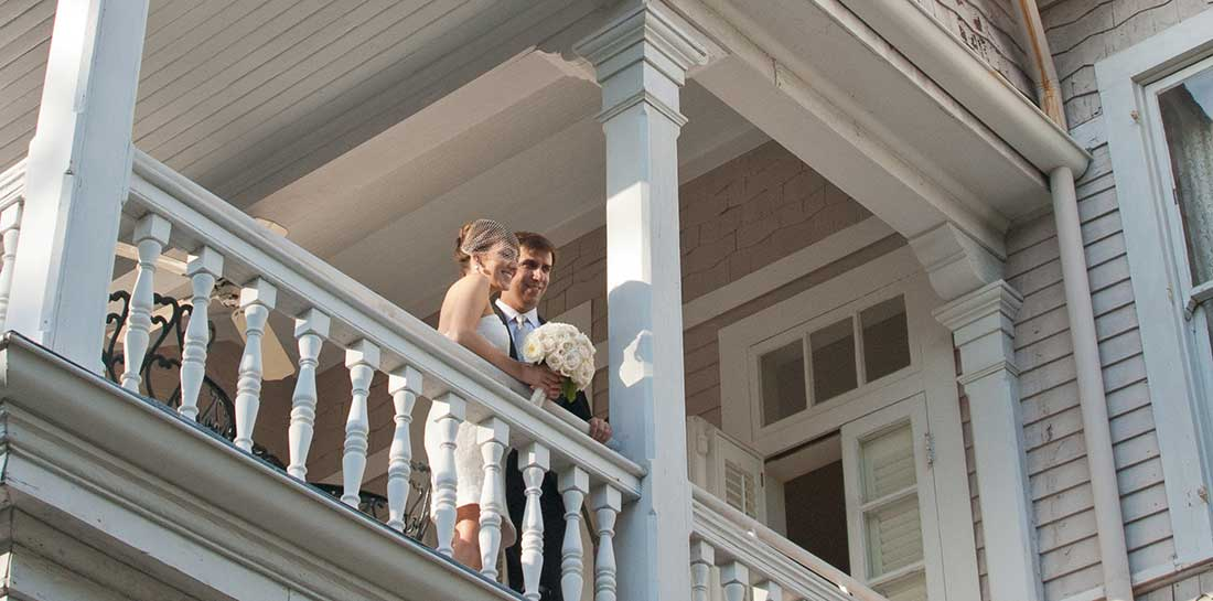Newlyweds look on at our New Orleans Inn