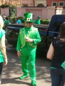 One of the marching club members decked out in green